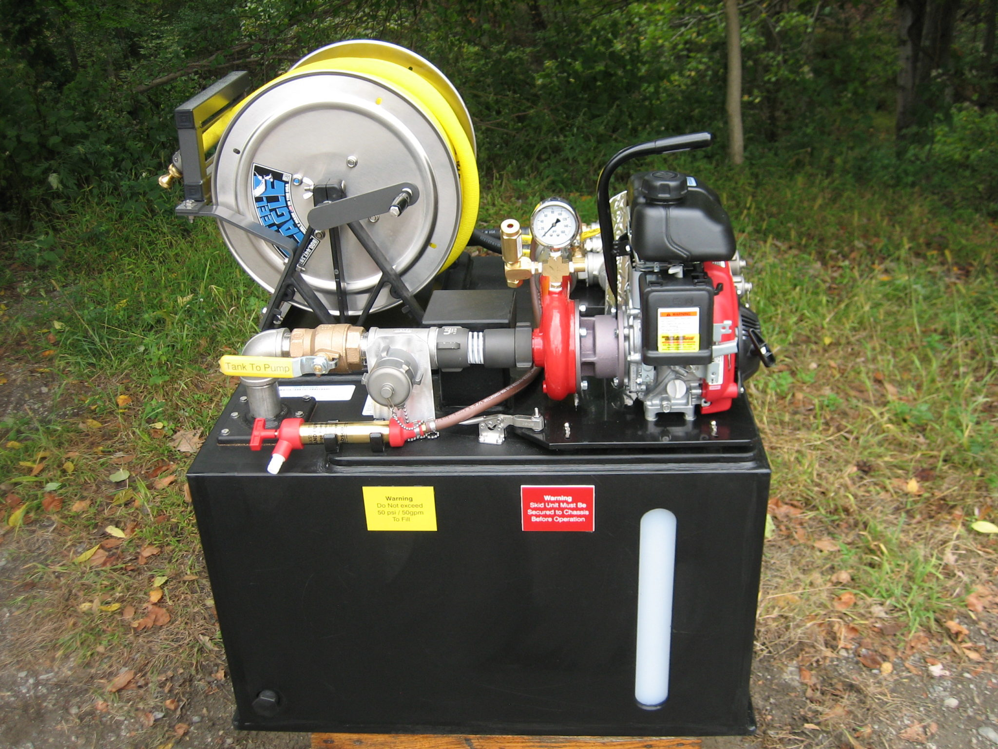 <p><strong>2</strong><br><em>The Simple 7 skid unit side view. Here you can see the reel, valves and tank capacity window.</em></p>