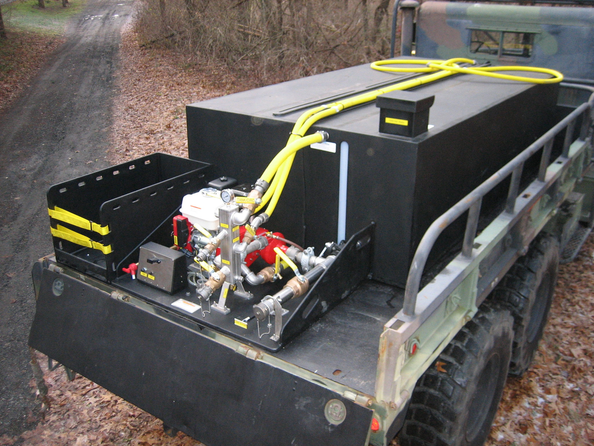 <p><strong>10</strong><br><em>750 gallon custom unit with hose tray for 5 ton.</em></p>